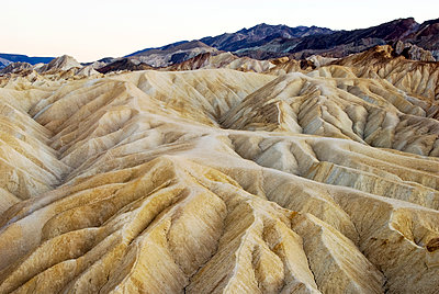 Looking out over odd sand formations at the famous Zabriskie Point overlook in Death Valley National Park, CA. - p1424m1501347 by Rachid Dahnoun