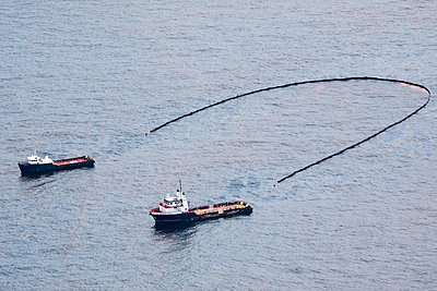 Boats cleaning up oil spill, Grand Isle, Louisiana, USA - p343m2025632 by Steele Burrow