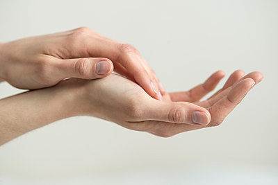 Hands touching skin to skin - p1041m1042347 by Franckaparis