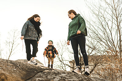 Women with daughter outdoor - p312m2207728 by Stina Gränfors