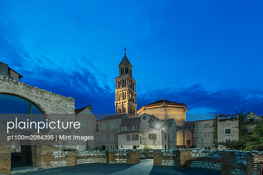 Buildings and tower illuminated at dusk, Split, Split, Croatia,Split, Split, Croatia - p1100m2084395 by Mint Images