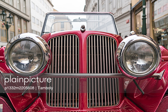 Red oldtimer in the old town of Prague - p1332m2205608 by Tamboly