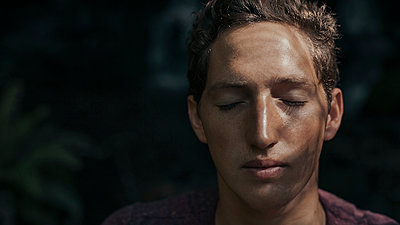 Young man with closed eyes - p1324m1191228 by michaelhopf