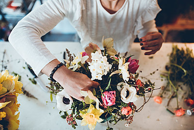 High angle midsection florist arranging flowers at store - p1166m1474271 by Cavan Images
