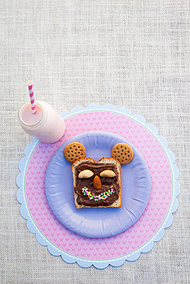 Still life of sweet food products made into smiley face - p429m819875f by Luka photography
