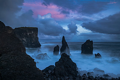 Sunset colours the skies over the pounding surf at the tip of the Reykenanes peninsula; Iceland - p442m1482833 by Robert Postma