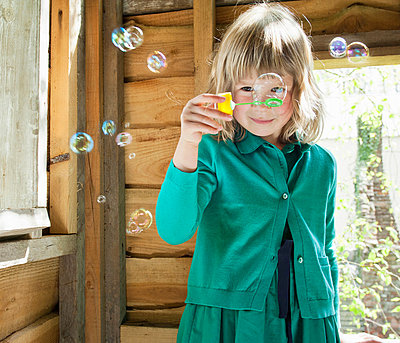 Girl playhouse with bubbles - p924m664843f by Mieke Dalle
