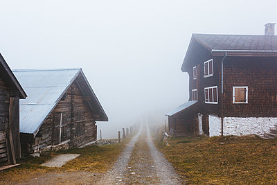 Village in the fog - p1177m2076539 by Philip Frowein
