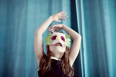 Llittle girl wearing mask - p623m923138f by Anne-Sophie Bost