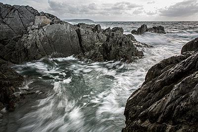 Rocky coastline and swirling sea - p1057m2008603 by Stephen Shepherd