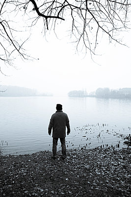 Man Stood By Lake - p975m954192 by Hayden Verry