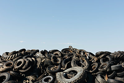 Pile of discarded auto and tractor tires in rural landfil, near Kildeer, Saskatchewan, Canada. - p1100m2002403 by Mint Images