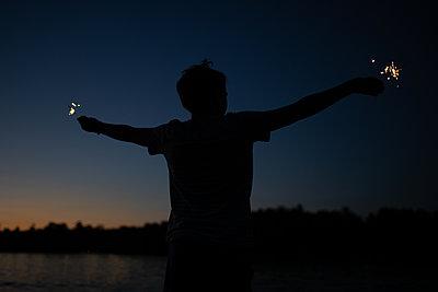 Boy with Sparklers - p1503m2015871 by Deb Schwedhelm
