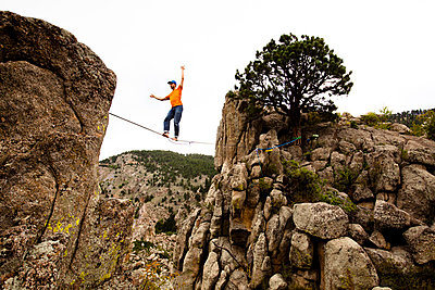 A male highliner walks the Elephant Buttresses highline in Boulder Canyon - p343m801181f by Kyle Sparks