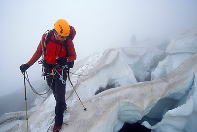 Climbers crossing dangerous crevasses in fog on Mt. Rainier, Washington - p343m1032133 by Jerry Dodrill