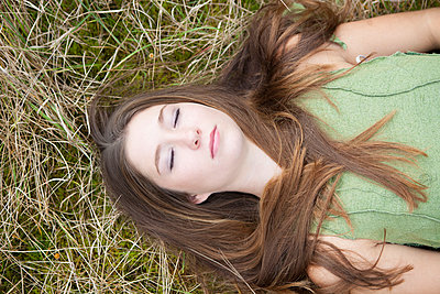 Lying on a meadow - p502m966219 by Tomas Adel