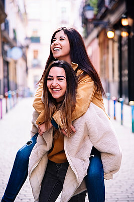 Beautiful Lesbian Couple Having Fun At The Street. LGBT Concept. - p1166m2165946 by Cavan Images