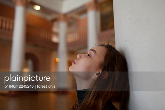 Young woman with long hair in a hall - p1646m2245243 by Slava Chistyakov