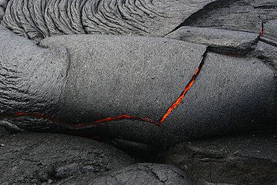 USA, Hawaii, Big Island, Pahoehoe volcano, burning lava flow, close up - p30017487f by Martin Rietze