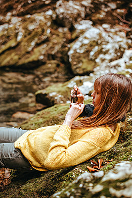 Woman taking a photo with her smartphone in the Vintgar Gorge in Slovenia - p1455m2081785 by Ingmar Wein