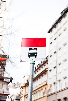 White and red bus stop traffic sign - p312m1551893 by Johner Images