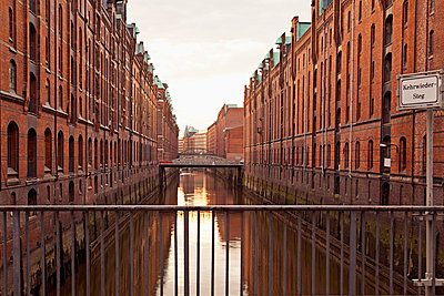 Old warehouses in Speicherstadt - p300m700673f by Mel Stuart