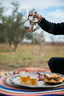 Pouring mint tea in Marrakesh - p1253m2168846 by Joseph Fox