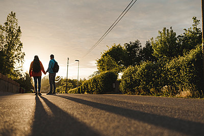 Couple of hikers standing on road - p312m2162184 by Stina Gränfors