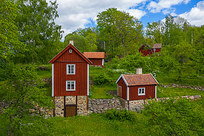 Wooden houses - p312m2145548 by Peter Lydén