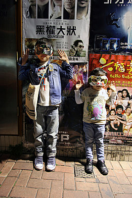 Two boys wearing masks - p664m900909 by Yom Lam