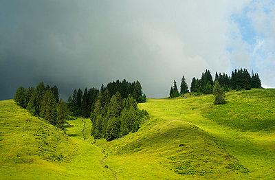 Clouds over rolling landscape, Salzburg, Austria - p429m824486 by Mischa Keijser