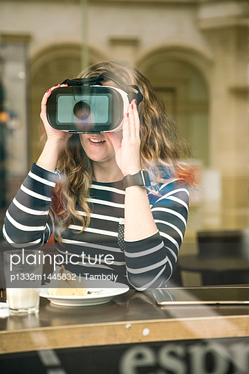 Woman using VR glasses - p1332m1445832 by Tamboly