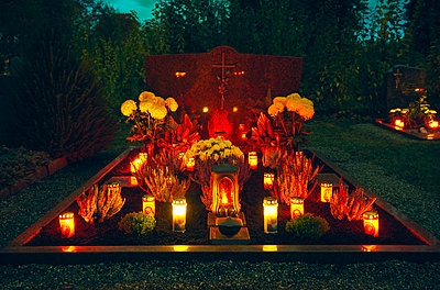 Grave with candles and flowers, All Saints - p1312m2193646 by Axel Killian