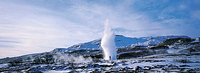 A person photographing geyser Strokkur in Haukadalur - p3487339 by Bjarki Reyr Asmundsson
