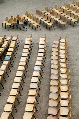 Chairs in rows - p977m944914 by Sandrine Pic