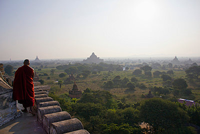 A view of the temples of Bagan, Burma and a Buddhist monk  - p301m714184f by Peter Erlemann