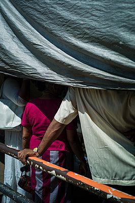 People stand nearby a handrail, Kandy, Sri Lanka, Asia - p934m1558815 by Sebastien Loffler