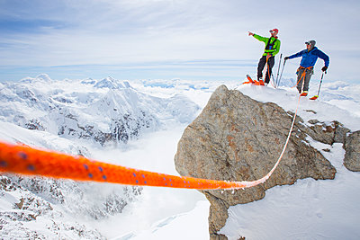 Two ski mountaineers standing on rock - p343m1475631 by Cavan Images