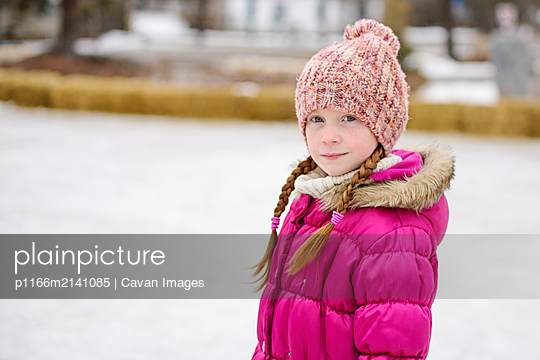 Little Girl Outdoors in Winter - p1166m2141085 by Cavan Images