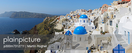 View of classical whitewashed church and bell tower at Oia