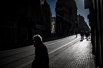 Sun shining in a dark paved street - p1007m1134124 by Tilby Vattard