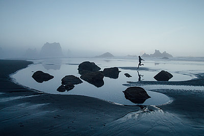 Woman Running on Oregon Coast - p1262m1082804 by Maryanne Gobble