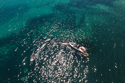 Sunbathing on the motor boat - p1437m2283327 by Achim Bunz