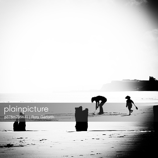 Children playing on beach - p378m795631 by Rory Garforth