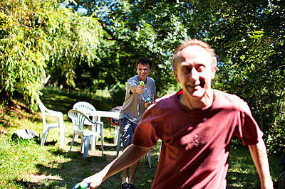 Two men playing with water guns 1 - p1007m854425 by Tilby Vattard