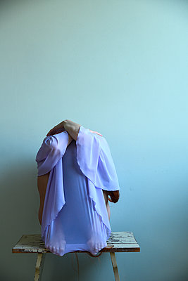 Woman with dress over face - p427m2210311 by Ralf Mohr