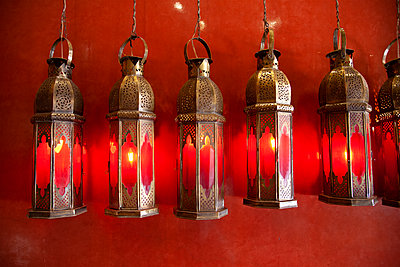 Row of Lanterns Against Red Wall - p1248m2109263 by miguel sobreira