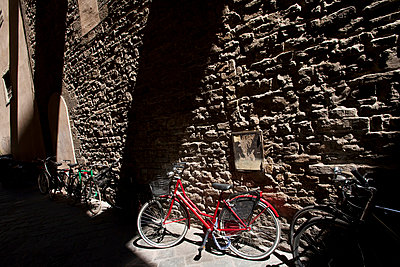 Lights, shadows and bicycles in a narrow Florence lane - p3314084 by Andrea Alborno