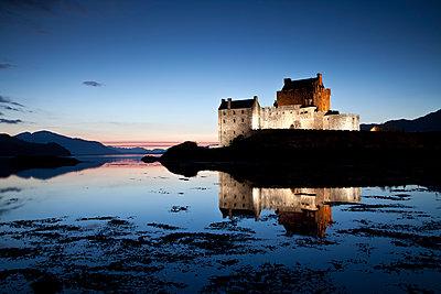 Eilean Donan Castle at Twilight, Dornie, Highland Region, Scotland - p651m2006763 by Tom Mackie