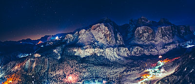 Mountain landscape of Dolomites at night. Village of Corvara in Badia. - p1053m2020020 by Joern Rynio